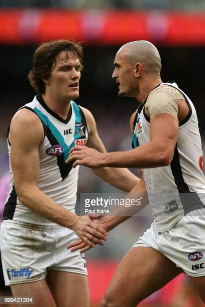 Sam PowellPepper of the Power celebrates a goal during the round 17 AFL match between the Fremantle Dockers and the Port Adelaide Power at Optus...