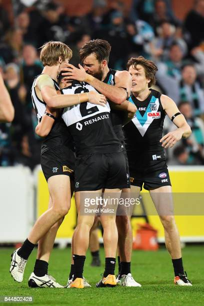 Sam PowellPepper Todd Marshall and Charlie Dixon of the Power celebrate during the AFL First Elimination Final match between Port Adelaide Power and...