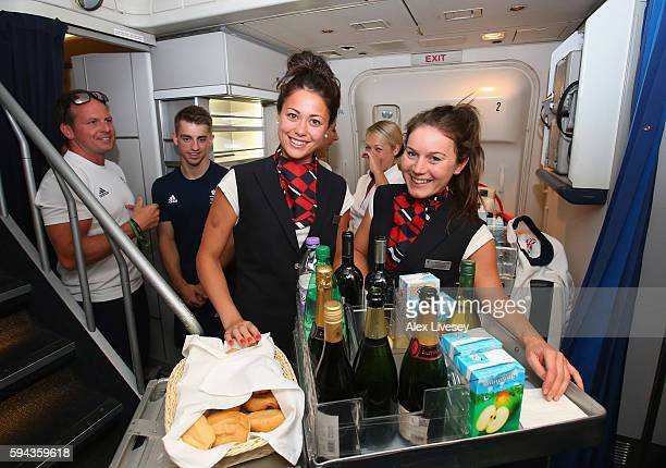 Sam Quek and Laura Unsworth of Great Britain dress up as cabin crew during the Team GB flight back from Rio on British Airways flight BA2016 on...