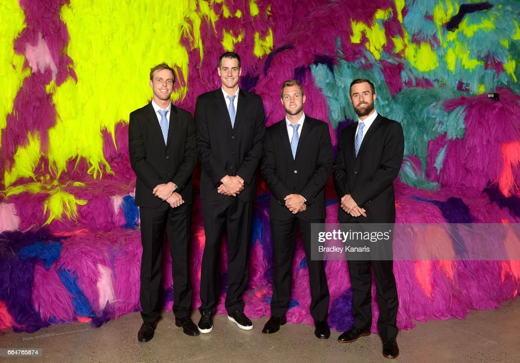 Sam Querrey, John Isner, Jack Sock and Steve Johnson of the USA pose for a photo before the official dinner at GOMA ahead of the Davis Cup World Group Quarterfinal match between Australia and the USA on April 5, 2017 in Brisbane, Australia.