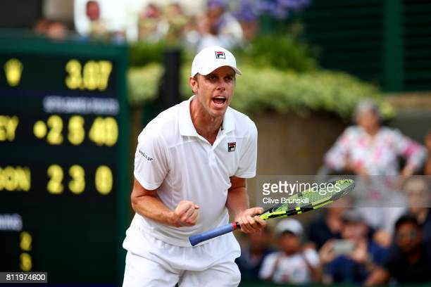 Sam Querrey of The United States celebrates match point and victory after the Gentlemen's Singles fourth round match against Kevin Anderson of South...