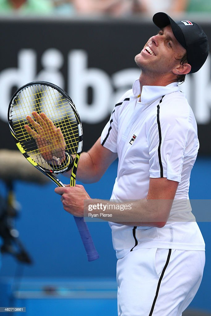 Sam Querrey of the United States celebrates winning in his second round match against Ernests Gulbis of Latvia during day three of the 2014 Australian Open at Melbourne Park on January 15, 2014 in Melbourne, Australia.