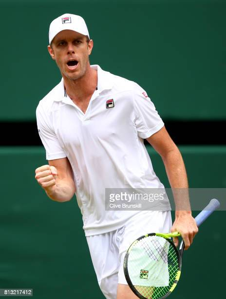 Sam Querrey of The United States celebrates winning the second set during the Gentlemen's Singles quarter final match against Andy Murray of Great...