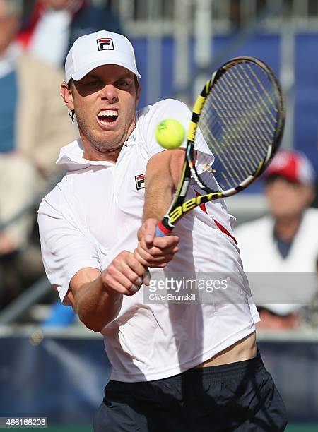 Sam Querrey of the United States plays a backhand against James Ward of Great Britain during day one of the Davis Cup World Group first round between...