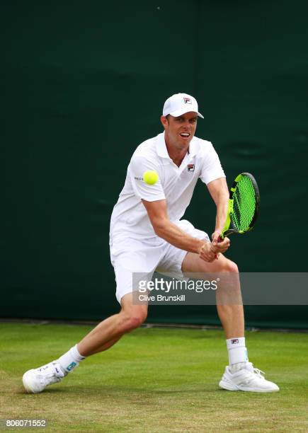 Sam Querrey of the United States plays a backhand during the Gentlemen's Singles first round match against Thomas Fabbiano of Italy on day one of the...