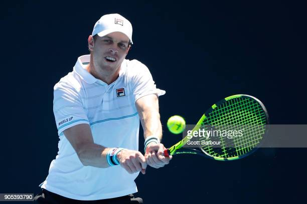Sam Querrey of the United States plays a backhand in his first round match against Feliciano Lopez of Spain on day two of the 2018 Australian Open at...
