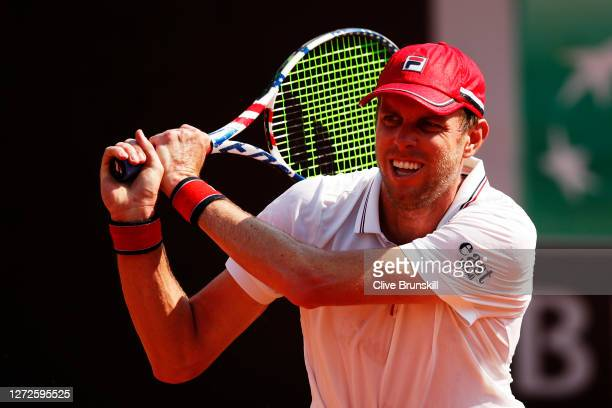 Sam Querrey of The United States plays a backhand in his round one match against Pedro Martinez of Spain during day two of the Internazionali BNL...