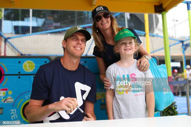 Sam Querrey of the United States poses with fans at Autograph Island during day one of the 2018 Australian Open at Melbourne Park on January 15 2018...