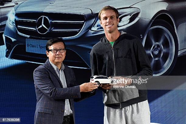 Sam Querrey of the United States receives a miniature Mercedes car at the Mercedes booth on day six of the 2016 China Open at the China National...