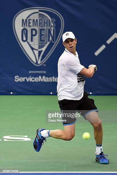 Sam Querrey of the United States returns a shot to Yoshihito Nishioka of Japan during their quarterfinal singles match on Day 5 of the Memphis Open...
