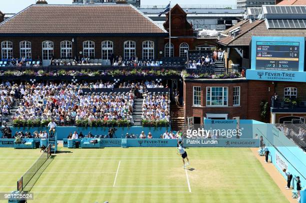 Sam Querrey of the United States serves during the match against Marin Cilic of Croatia during Day five of the FeverTree Championships at Queens Club...
