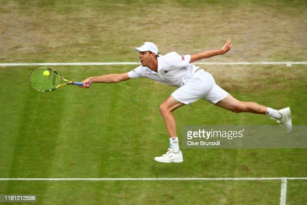 Sam Querrey of the United States stretches to play a forehand in his Men's Singles Quarter Final match against Rafael Nadal of Spain during Day Nine...