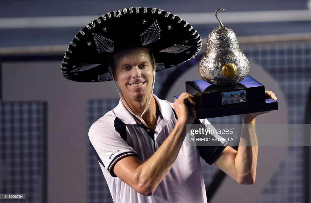 Sam Querrey of the US celebrates with the trophy after beating Rafael Nadal of Spain 6-3, 7-6 (7/3) in the ATP men's singles finals of the Mexican Tennis Open in Acapulco, Guerrero State, Mexico, on March 4, 2017. /