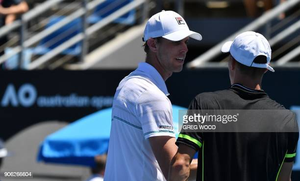 Sam Querrey of the US congratulates Hungary's Marton Fucsovics after their men's singles second round match on day four of the Australian Open tennis...