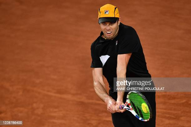Sam Querrey of the US returns the ball to Russia's Andrey Rublev during their men's singles first round tennis match at the Simonne Mathieu court on...