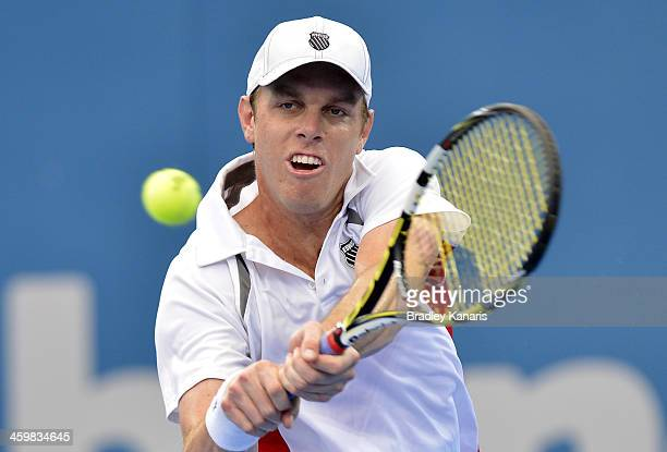 Sam Querrey of the USA plays a backhand in his match against Marinko Matosevic of Australia during day four of the 2014 Brisbane International at...