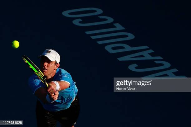 Sam Querrey of United States returns a ball during the match against John Isner of United States as part of the day 3 of the Telcel Mexican Open 2019...