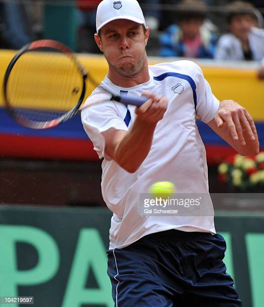 Sam Querrey of US in action against Colombian tennis player Santiago Giraldo during a match as part of Davis Cup World Group Playoffs at La...