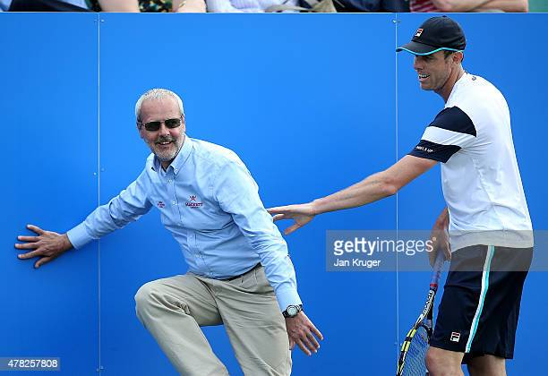 Sam Querrey of USA checks on a linesman after a colliding with him in his match against Pablo Cuevas of Uruguay on day four of the Aegon Open...