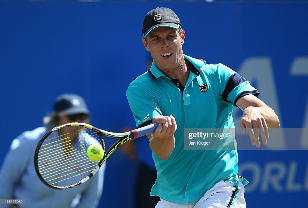 Sam Querrey of USA in action against Denis Istomin of Uzbekistan during the mens singles final match on day seven of the Aegon Open Nottingham at Nottingham Tennis Centre on June 27, 2015 in Nottingham, England.