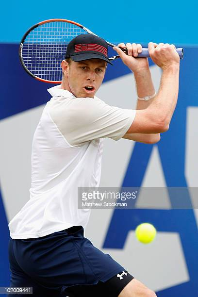 Sam Querrey of USA plays a shot during his semi final match against Rainer Schuettler of Germany on Day 6 of the the AEGON Championships at Queen's...