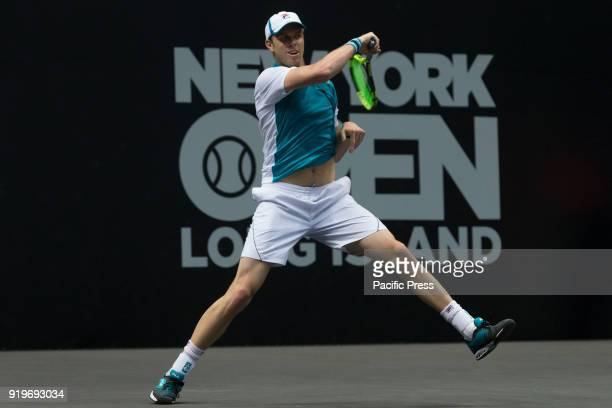 Sam Querrey of USA returns a ball during 2nd round match against Mikhail Youzhny of Russia at ATP 250 New York Open tournament at Nassau Coliseum