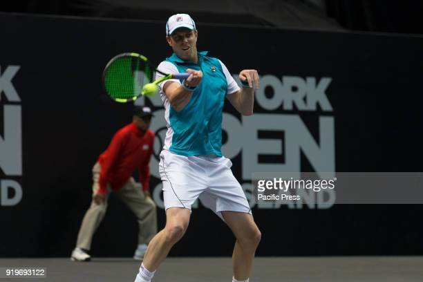 Sam Querrey of USA serves ball during 2nd round match against Mikhail Youzhny of Russia at ATP 250 New York Open tournament at Nassau Coliseum