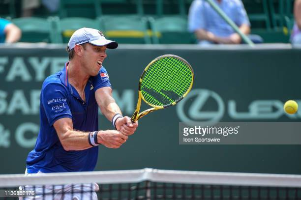 Sam Querrey returns a shot during the men's clay court semifinals singles match on April 13, 2019 at River Oaks Country Club in Houston, Texas.