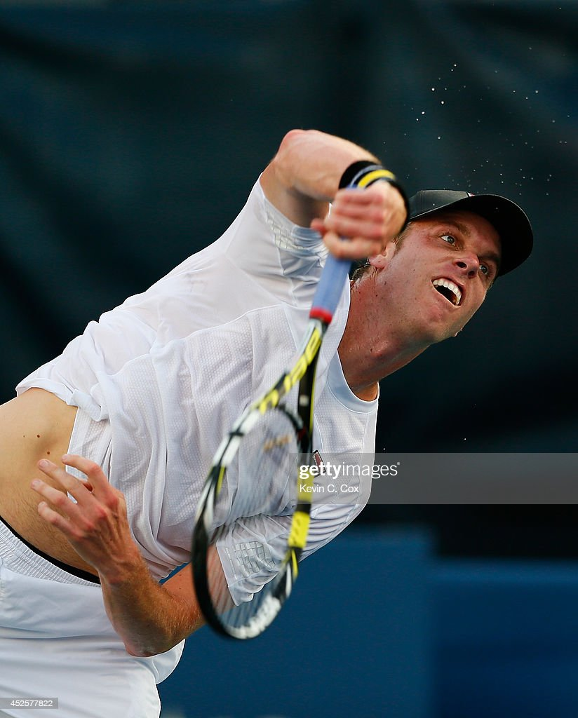 Sam Querrey serves to Dudi Sela of Israel during the BB&T Atlanta Open at Atlantic Station on July 23, 2014 in Atlanta, Georgia.