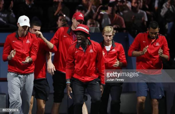 Sam Querrey Thanasi Kokkinakis John Isner Denis Shapovalov Frances Tiafoe and Nick Kyrgios of Team World watch Rafael Nadal of Team Europe as he...