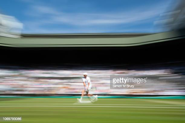 Sam Querry from the USA in action against Gael Monfils from France during The Wimbledon Lawn Tennis Championship at the All England Lawn Tennis and...