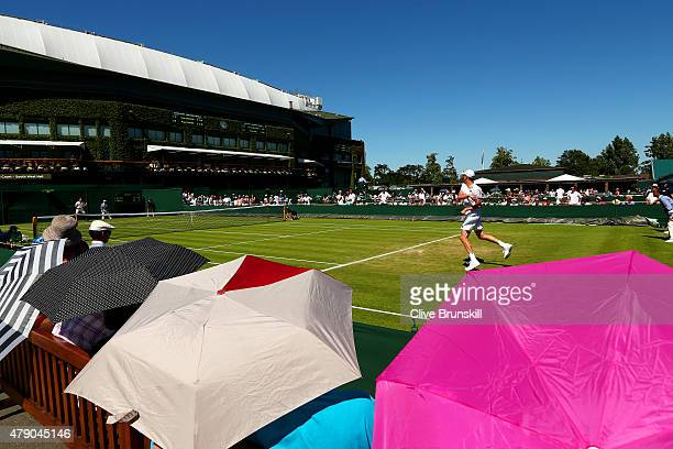 Sam Querry of the United States in action in his Gentlemens Singles first round match against Igor Sijsling of Netherlands during day two of the...