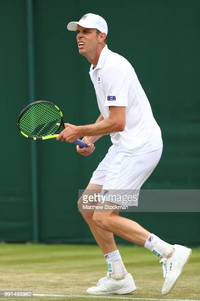 Sam Querry of The United States reacts during his Men's Singles second round match against Sergiy Stakhovsky on day three of the Wimbledon Lawn...