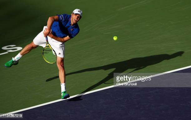 Sam Querry of the United States serves against Matteo Berrettini of Italy during their men's singles first round match on day four of the BNP Paribas...