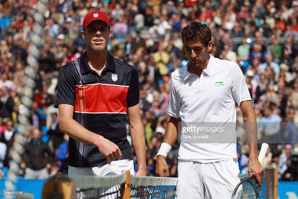 Sam Querry of the USA (L) looks on after his mens singles semi-final match against Marin Cilic of Croatia on day six of the AEGON Championships at Queens Club on June 16, 2012 in London, England.