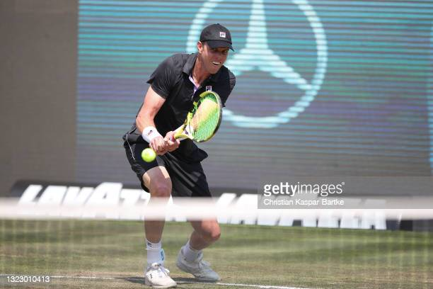 Sam Querry of United States of America plays a backhand during his match against Dominic Stricker of Switzerland during day 5 of the MercedesCup at...