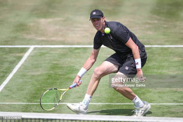 Sam Querry of United States of America plays a forehand during his match against Dominic Stricker of Switzerland during day 5 of the MercedesCup at...