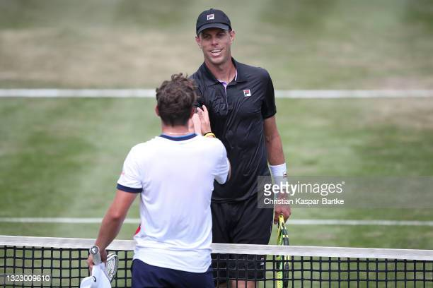 Sam Querry of United States of America shakes hands after winning his match against Dominic Stricker of Switzerland during day 5 of the MercedesCup...