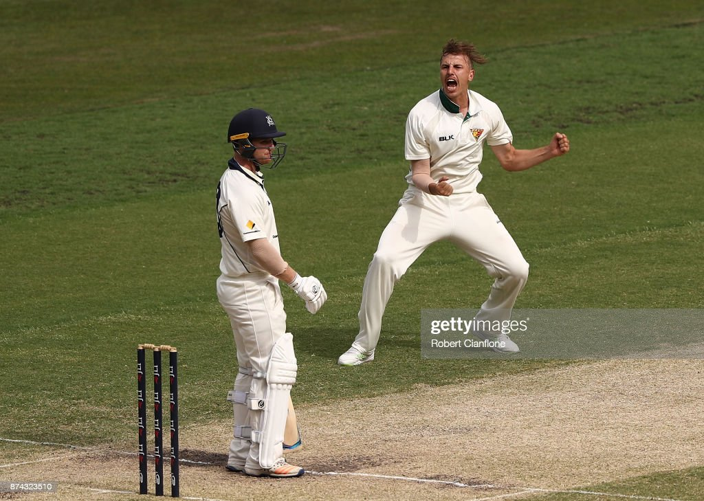Sam Rainbird of Tasmania celebrates after taking the wicket of Travis Dean of Victoria during day three of the Sheffield Shield match between Victoria and Tasmania at Melbourne Cricket Ground on November 15, 2017 in Melbourne, Australia.