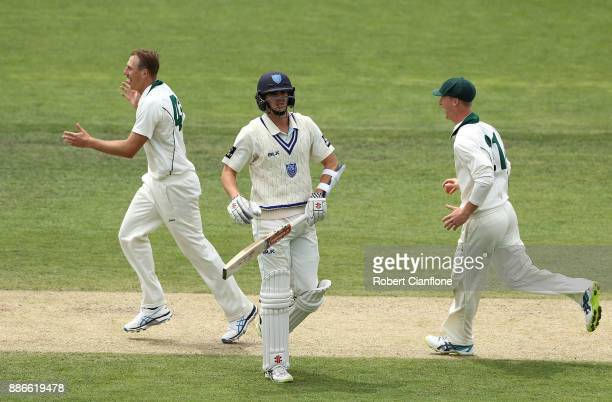 Sam Rainbird of Tasmania celebrates taking the wicket of Steve O'Keefe of NSW during day four of the Sheffield Shield match between New South Wales...