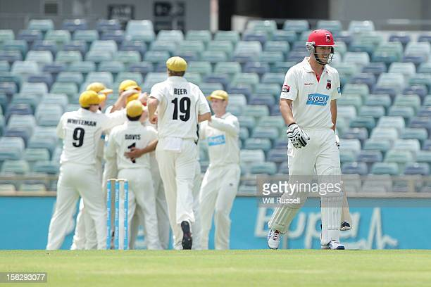 Sam Raphael of the Redbacks leaves the field after being caught by Tom Triffitt of a Mitchell Johnson ball during day two of the Sheffield Shield...