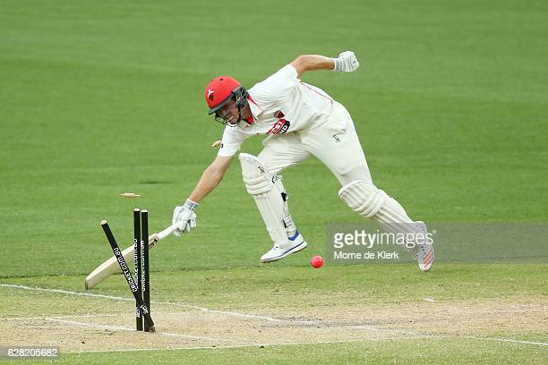 Sam Raphael of the SA Redbacks is runout after a direct hit by Ed Cowan of the NSW Blues during day three of the Sheffield Shield match between South...