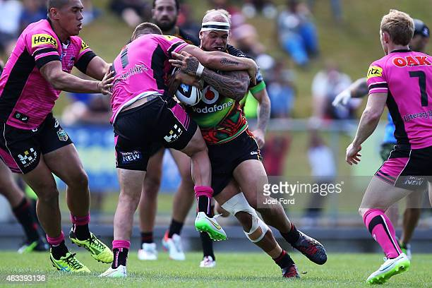 Sam Rapira of the New Zeland Warriors is tackled during the NRL Trial match between the New Zealand Warriors and the Penrith Panthers on February 14...