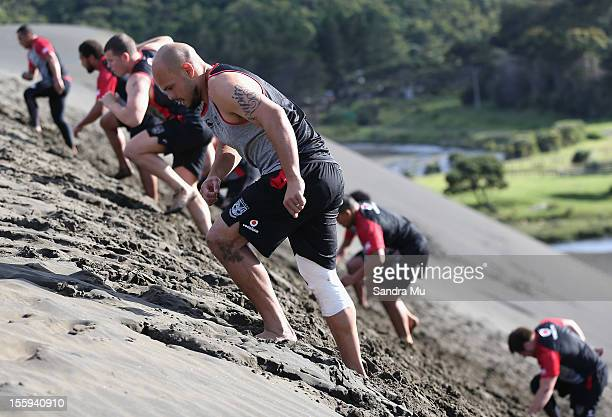 Sam Rapira of the Warriors trains on the sand dunes during the New Zealand Warriors NRL training session at Bethells Beach on November 10 2012 in...
