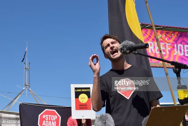 Sam Regester from the political campaign group GetUp speaks to protesters gathered in front of Parliament House to campaign against the construction...