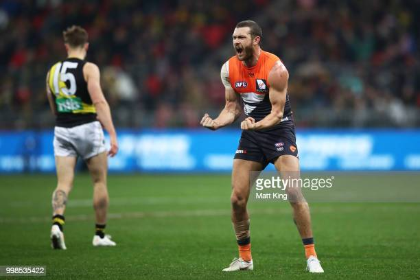 Sam Reid of the Giants celebrates victory at fulltime during the round 17 AFL match between the Greater Western Sydney Giants and the Richmond Tigers...