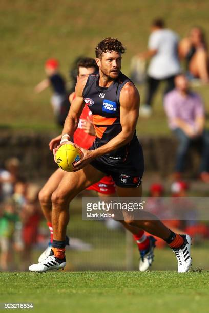 Sam Reid of the Giants runs with the ball during the AFL Inter Club match between the Sydney Swans and the Greater Western Sydney Giants at Henson...