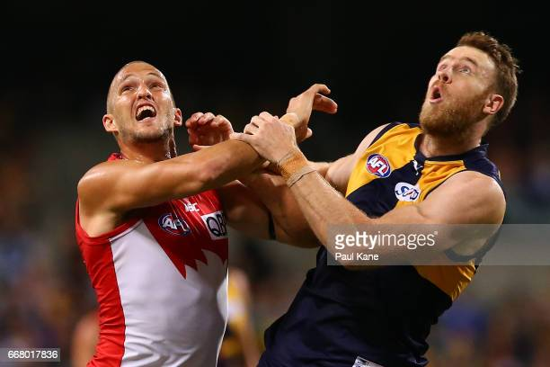 Sam Reid of the Swans and Jonathan Giles of the Eagles contest the ruck during the round four AFL match between the West Coast Eagles and the Sydney...
