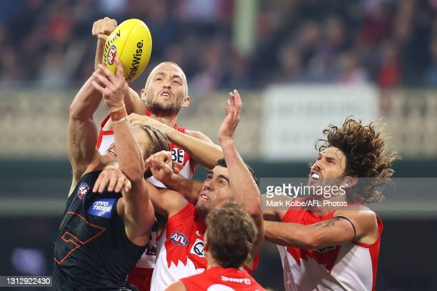Sam Reid of the Swans spoils as Harry Himmelberg of the Giants attempts to mark during the round five AFL match between the Sydney Swans and the...