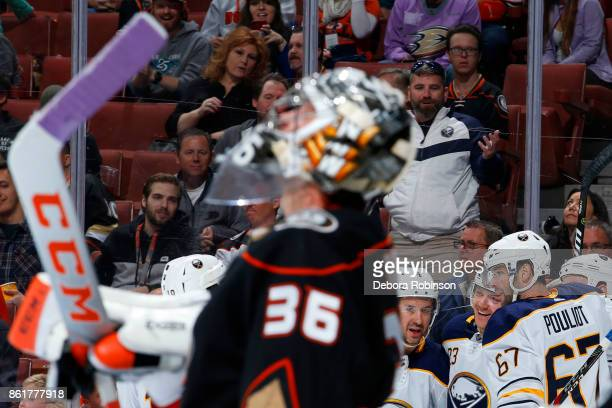 Sam Reinhart Josh Gorges and Benoit Pouliot of the Buffalo Sabres celebrate a goal in the second period against John Gibson of the Anaheim Ducks...